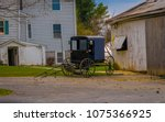 Amish Buggy Parked Outside The...