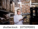 young cheerful female worker is ... | Shutterstock . vector #1075390001