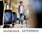 young cheerful man walking... | Shutterstock . vector #1075390055