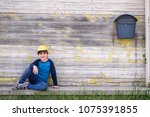 portrait of a cute cheerful boy ... | Shutterstock . vector #1075391855