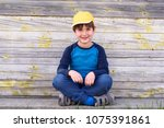 portrait of a cute cheerful boy ... | Shutterstock . vector #1075391861