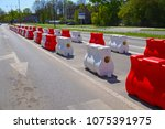 street with lanes delimited by... | Shutterstock . vector #1075391975