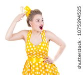 cheerful rockabilly girl in... | Shutterstock . vector #1075394525