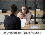 confident millennial female... | Shutterstock . vector #1075401554