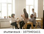 smiling multiracial colleagues... | Shutterstock . vector #1075401611