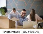 smiling new male employee... | Shutterstock . vector #1075401641