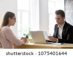 serious hr attentively reading... | Shutterstock . vector #1075401644