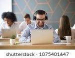 smiling businessman wearing... | Shutterstock . vector #1075401647