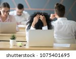 frustrated african woman... | Shutterstock . vector #1075401695