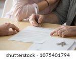 couple renters tenants signing... | Shutterstock . vector #1075401794