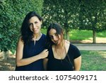 two women sisters smiling with... | Shutterstock . vector #1075409171