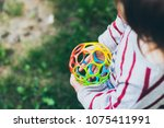little girl holding colorful... | Shutterstock . vector #1075411991