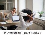 diverse colleagues relaxing... | Shutterstock . vector #1075420697