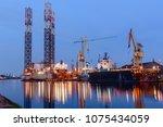 oil rig docked in shipyard of... | Shutterstock . vector #1075434059