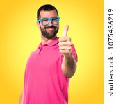 man in colorful clothes with... | Shutterstock . vector #1075436219