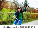 cheerful modern hipster... | Shutterstock . vector #1075439555