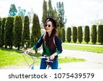 cheerful modern hipster... | Shutterstock . vector #1075439579