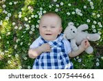 cute toddler boy with teddy... | Shutterstock . vector #1075444661