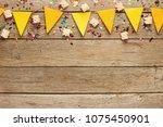yellow paper flags garland on... | Shutterstock . vector #1075450901