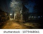 dark and eerie urban city alley ... | Shutterstock . vector #1075468061