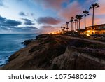 houses lit up at sunset on... | Shutterstock . vector #1075480229