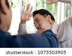 asian businessmen quarrel  the... | Shutterstock . vector #1075503905