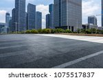 empty road with modern business ... | Shutterstock . vector #1075517837