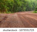 red dirt road in rural | Shutterstock . vector #1075551725