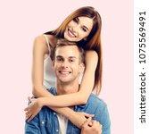 portrait of young happy couple  ... | Shutterstock . vector #1075569491
