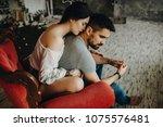 very beautiful couple sitting... | Shutterstock . vector #1075576481