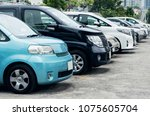 cars parked on parking in row | Shutterstock . vector #1075605704
