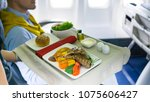 tray of food on the aircraft | Shutterstock . vector #1075606427