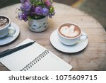 hot latte art in coffee cup... | Shutterstock . vector #1075609715