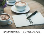 pen and small notebook on wood... | Shutterstock . vector #1075609721