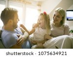 young happy family at home. | Shutterstock . vector #1075634921
