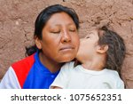little latin girl giving kiss... | Shutterstock . vector #1075652351