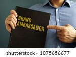 man is holding book with title... | Shutterstock . vector #1075656677