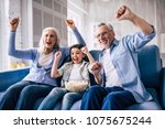 the happy girl and grandparents ... | Shutterstock . vector #1075675244