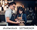 asia barista waiter take order... | Shutterstock . vector #1075682624
