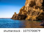 lagos caves and seashore with... | Shutterstock . vector #1075700879