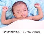 close up of newborn sleeping | Shutterstock . vector #1075709501