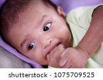 newborn baby self soothing | Shutterstock . vector #1075709525