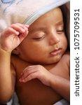 close up of newborn sleeping | Shutterstock . vector #1075709531