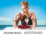 woman in a swimsuit with a... | Shutterstock . vector #1075731425