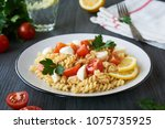 pasta salad with cherry... | Shutterstock . vector #1075735925