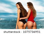 two hot girls posing on the... | Shutterstock . vector #1075736951
