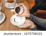 woman guessing on the coffee... | Shutterstock . vector #1075758101