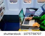 passenger using laptop computer ... | Shutterstock . vector #1075758707
