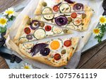 open pie with vegetables and... | Shutterstock . vector #1075761119