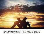 sad couple sitting back to back ...   Shutterstock . vector #1075771577